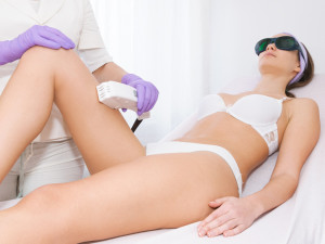 man having stone massage in spa salon